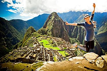 Laura Grier jumping at Machu Picchu ruins, Peru, South America