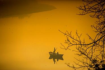 Sunrise over a boat on the Taj Mahal lake, Agra, Uttar Pradesh, India, Asia