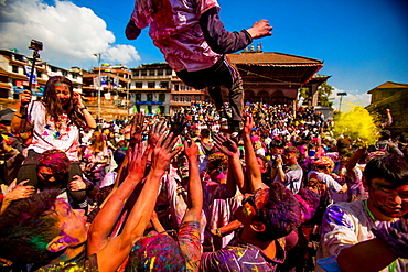 Crowd throwing pigment at the Holi Festival, Durbar Square, Kathmandu, Nepal, Asia