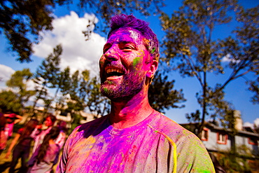 Man with face painted at the Holi Festival, Kathmandu, Nepal, Asia
