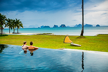 Couple relaxing in the pool on Koh Yao Noi Island, Thailand, Southeast Asia, Asia