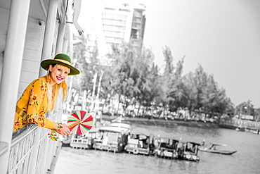 American woman tourist aboard the Mekong Princess as it sails down the Mekong Delta from Cambodia to Vietnam, Indochina, Southeast Asia, Asia