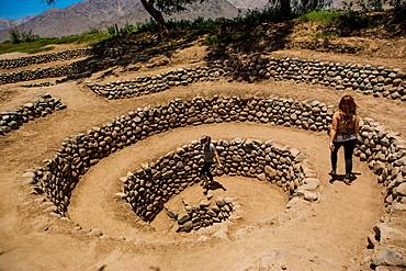 Girls at Aqueducts at Nasca, Peru, South America