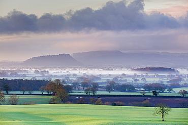 Low winter light rakes across the Cheshire plain with Beeston Castle and the Peckforton sandstone ridge beyond, Cheshire, England, United Kingdom, Europe