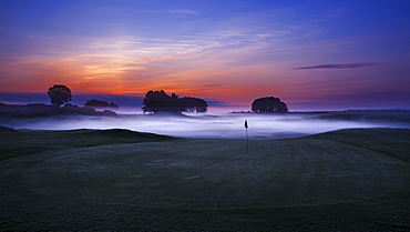 Dawn sky extending beyond the mist low lying in the sunken fairways of Delamere Forest Golf Club on a spring morning, Cheshire, England, United Kingdom, Europe