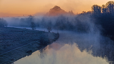 Winter dawn along the River Weaver with mist lingering among the trees and fields, Cheshire, England, United Kingdom, Europe