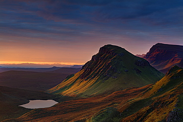 First light of a new morning strikes The Cleat on the Trotternish peninsula, Isle of Skye, Inner Hebrides, Scotland, United Kingdom, Europe