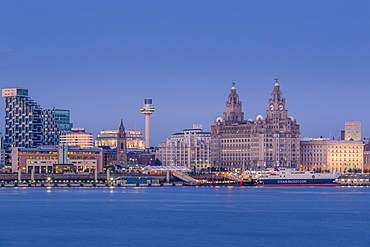 Looking across the River Mersey to the Liverpool skyline and Liver buildings at dusk, Liverpool, Merseyside, England, United Kingdom, Europe