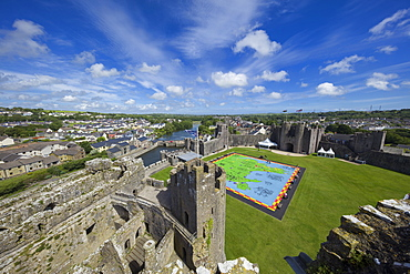 The medieval Pembroke Castle dominates the landscape high above the town and river, Pembroke, Wales, United Kingdom, Europe