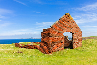 Red brick buildings, ruins of the industrial quarrying activity near to Porthgain harbour, Pembrokeshire, Wales, United Kingdom, Europe