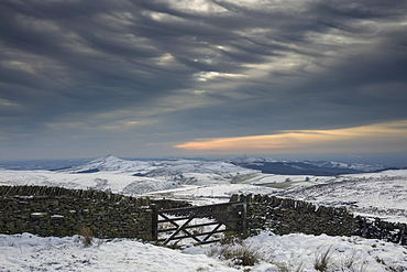 Winter afternoon in the snow covered Peak District looking across the White Peak to Shutlingsloe, Cheshire, England, United Kingdom, Europe