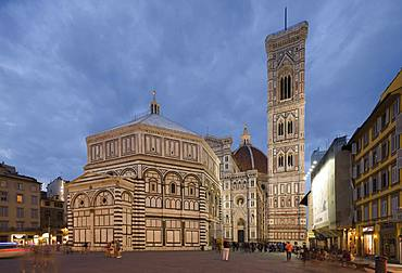 The Florence Campanile and Cathedral in the early evening with people walking around the Piazza Di San Giovanni, Florence, UNESCO World Heritage Site, Tuscany, Italy, Europe