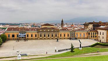 Looking to the west wing of the Palazzo Pitti and beyond to the centre of Florence from the Boboli Gardens, Florence, Tuscany, Italy, Europe