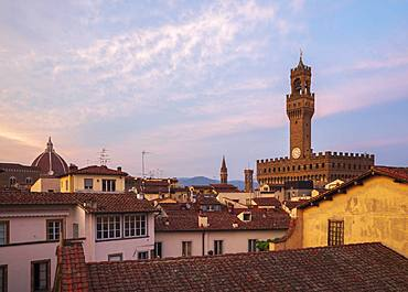 Looking over the rooftops of the historic centre of Florence to the Palazzo Vecchio at dusk, Florence, UNESCO World Heritage Site, Tuscany, Italy, Europe