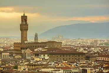 Looking across the rooftops of central Florence to The Palazzo Vecchio and the distant Apennine mountains, Florence, Tuscany, Italy, Europe