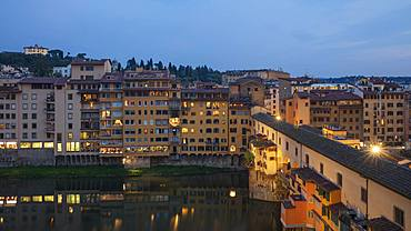 Looking across the Ponte Vecchio to the Oltrarno region of Florence lit in early evening light, Florence, Tuscany, Italy, Europe