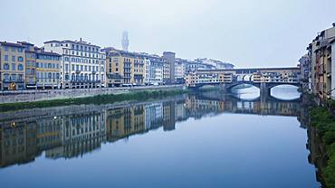The Ponte Vecchio on the Arno River on a misty morning with the Palazzo Vecchio shrouded in mist, Florence, UNESCO World Heritage Site, Tuscany, Italy, Europe