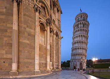 People relaxing on the steps of the Cathedral (Duomo) at twilight with the Leaning Tower of Pisa (Torre Pendente) beyond, UNESCO World Heritage Site, Pisa, Tuscany, Italy, Europe