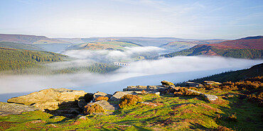 Early morning fog lingering above the Ladybower reservoir in the valley below Bamford Edge