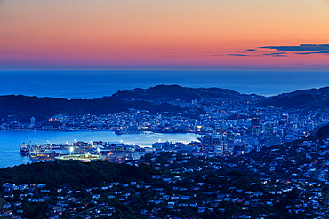 Overlooking the city of Wellington, its harbour and beyond to the Cook Straits at dusk, Wellington, North Island, New Zealand, Pacific