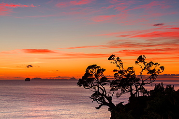 A dawn sky above the Alderman Islands in the South Pacific from New Zealand's Coromandel Peninsula, Waikato, North Island, New Zealand, Pacific