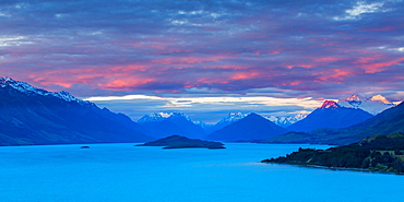 Mount Earnslaw and neighbouring mountain peaks in the Southern Alps are lit with the last rays of the sun beyond Lake Wakatipu, Otago, South Island, New Zealand, Pacific