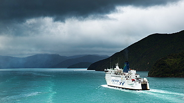A ferry heads along Queen Charlotte sound for the Cook Straits on a journey from Picton to Wellington, New Zealand, Pacific