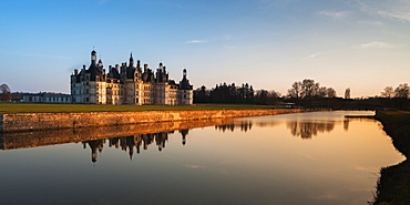 North west facade of Chateau de Chambord in the Loire Valley reflected in the River Cosson, UNESCO World Heritage Site, Loir et Cher, Pays de la Loire, Centre, France, Europe