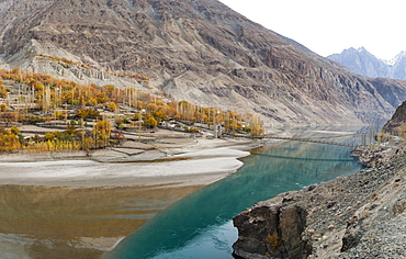 Gupis village on the banks of Khalti Lake which is part of the Gilgit River, seen here from the Shandur-Gilgit road, Ghizer District, in north Pakistan, Asia