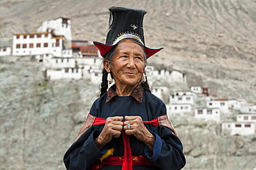 A Nubra woman wears traditional dress to attend a gathering at a local monastery in the Nubra Valley, Ladakh, India, Asia