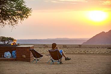 Sunset on the edge of the Namib Desert at the Namib Desert Lodge, Namibia, Africa