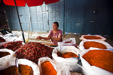 A woman selling spices on a market stall in Shan State, Myanmar (Burma), Asia