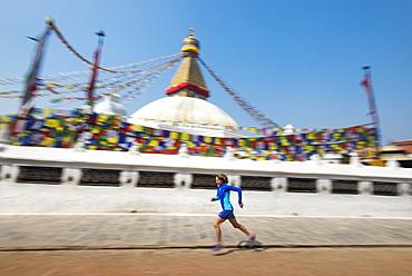 Marathon Ultra Runner Lizzy Hawker running around Bouddha (Boudhanath) (Bodnath) Stupa in Kathmandu, Nepal, Asia