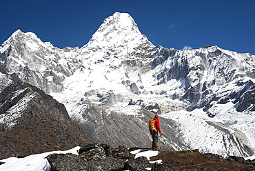 A trekker stops to admire the views of Ama Dablam in the Everest region, Khumbu Region, Himalayas, Nepal, Asia