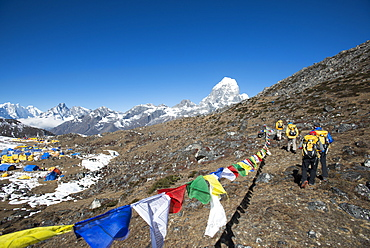 A team of four climbers return to base camp after climbing Ama Dablam in the Nepal Himalayas, Khumbu Region, Nepal, Asia
