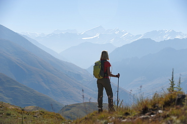 Taking a pause from the trail at a viewpoint in the Juphal valley in the remote Dolpa region, Himalayas, Nepal, Asia