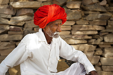A an old man from Bundi rests during the hot hours of the day, Rajasthan, India, Asia
