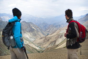 Stopping to savour the views from the top of the Konze La, 4900m, during the Hidden Valleys trek, Ladakh, India, Asia
