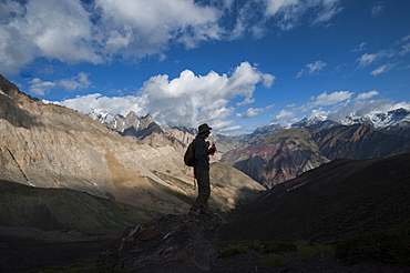 Stopping to savour the views from the top of the Dung Dung La during the Hidden Valleys trek in Ladakh, a remote Himalayan region, India, Asia