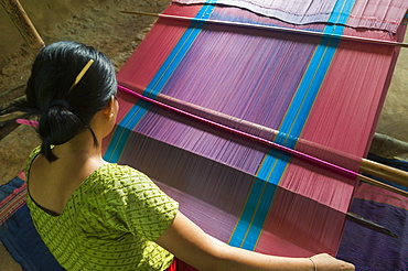 A woman weaves traditional clothes using a hand loom, Chittagong Hill Tracts, Bangladesh, Asia
