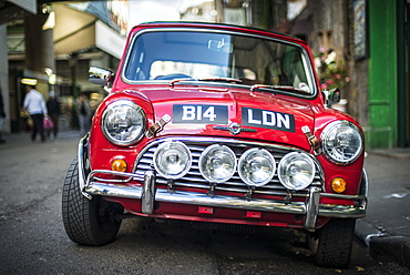A classic red Mini Cooper parked outside Borough Market in London, England, United Kingdom, Europe
