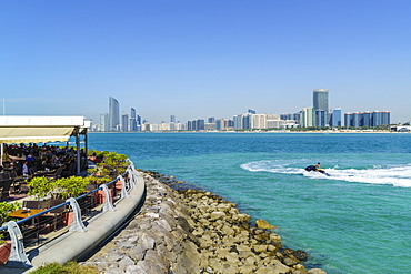 View from the Breakwater to the city skyline across the Gulf, Abu Dhabi, United Arab Emirates, Middle East