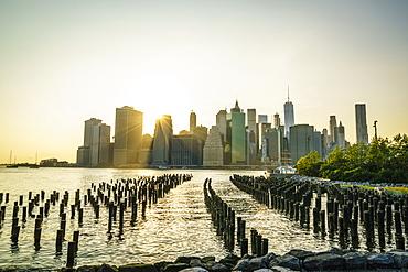 Lower Manhattan skyline across the East River at sunset, New York City, New York, United States of America, North America