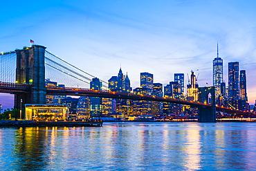 Brooklyn Bridge and Manhattan skyline at dusk, New York City, United States of America, North America