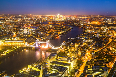 High view of London skyline at night along the River Thames from Tower Bridge to Canary Wharf, London, England, United Kingdom, Europe