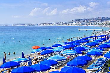 Blue parasols on the beach, Promenade des Anglais, Nice, Alpes Maritimes, Cote d'Azur, Provence, France, Mediterranean, Europe