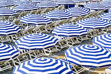 Blue and white beach parasols, Nice, Alpes Maritimes, Cote d'Azur, Provence, France, Mediterranean, Europe