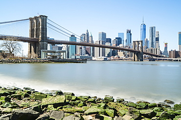 Brooklyn Bridge and Lower Manhattan skyline viewed from Brooklyn side of East River, New York City, United States of America, North America