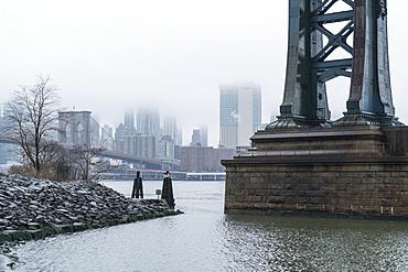 Manhattan Bridge on a cold foggy day, Brooklyn Bridge and skyline beyond, New York City, United States of America, North America