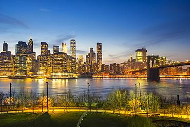 Manhattan skyline and Brooklyn Bridge at dusk, New York City, United States of America, North America